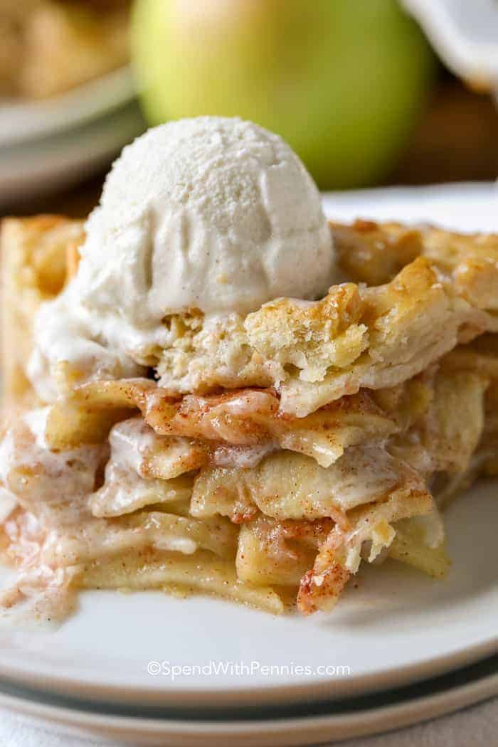 Apple pie with ice cream on a plate.