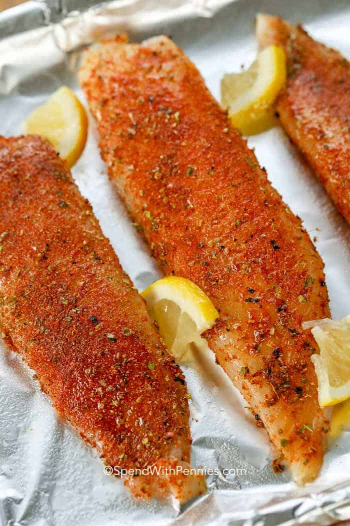 Blackened tilapia preparation of Tilapia Fillets with blackened seasoning ready to bake