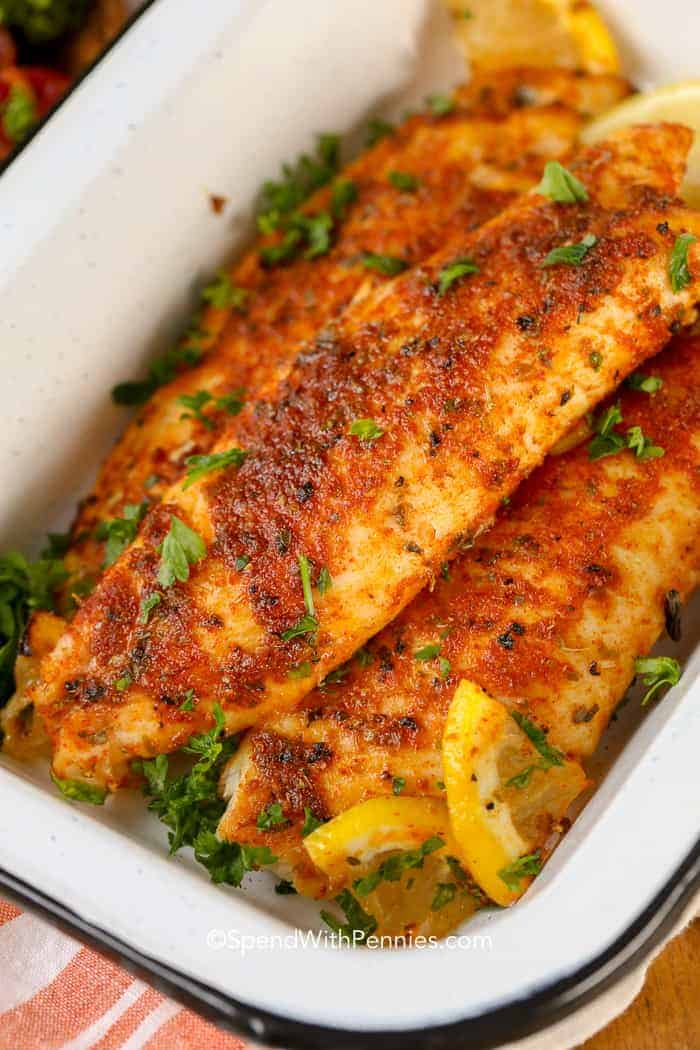 Blackened Tilapia in a serving dish with lemon to create the best blackened fish recipe.