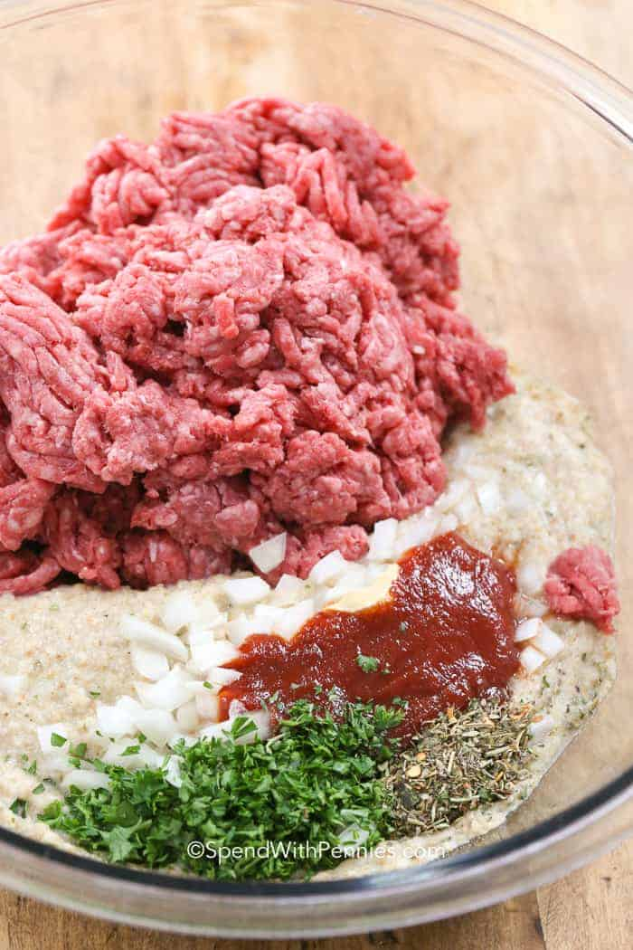 Ingredients for making meatloaf in a glass bowl