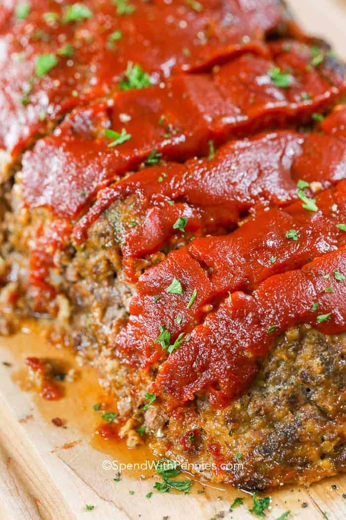 Juicy meatloaf on a cutting board ready to eat!