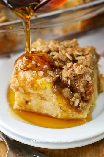 Pouring syrup on a piece of French Toast Casserole