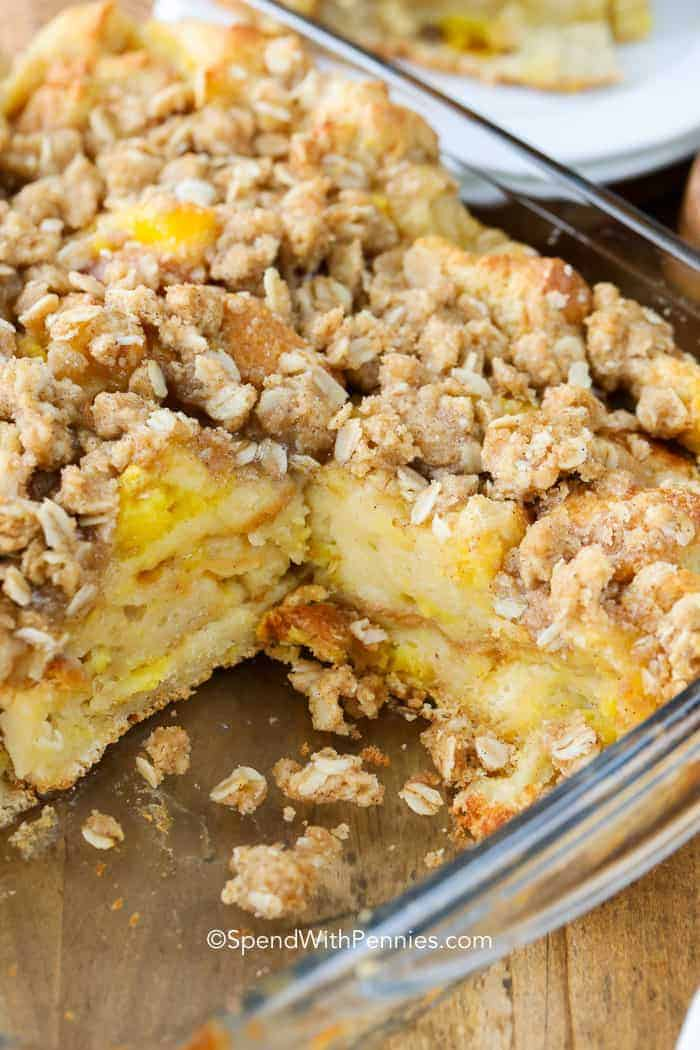 French Toast Casserole in a clear baking dish with slice taken out of it