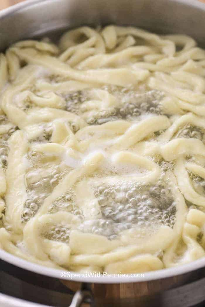 Egg Noodles cooking in boiling salted water - made from the best egg noodle recipe!