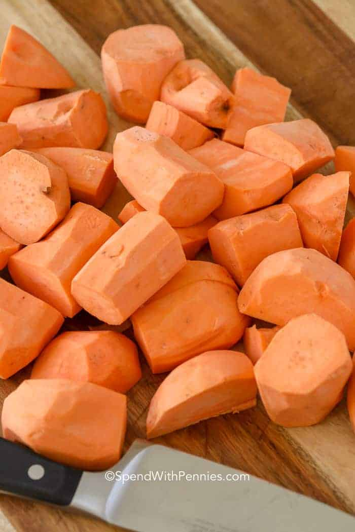 Peeled and chunked sweet potatoes ready to be boiled for mashed sweet potatoes