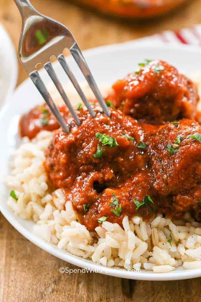 A plate of tender meatballs in a zesty sauce - a family favorite meal.
