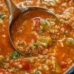 Overhead shot of ladle full of Stuffed Pepper Soup