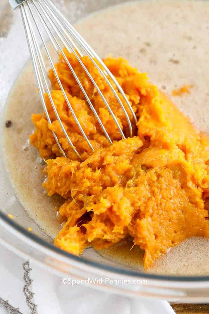 Mixing sweet potato pie ingredients in a bowl