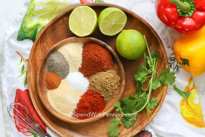 All fajita seasoning ingredients on a plate before being combined.