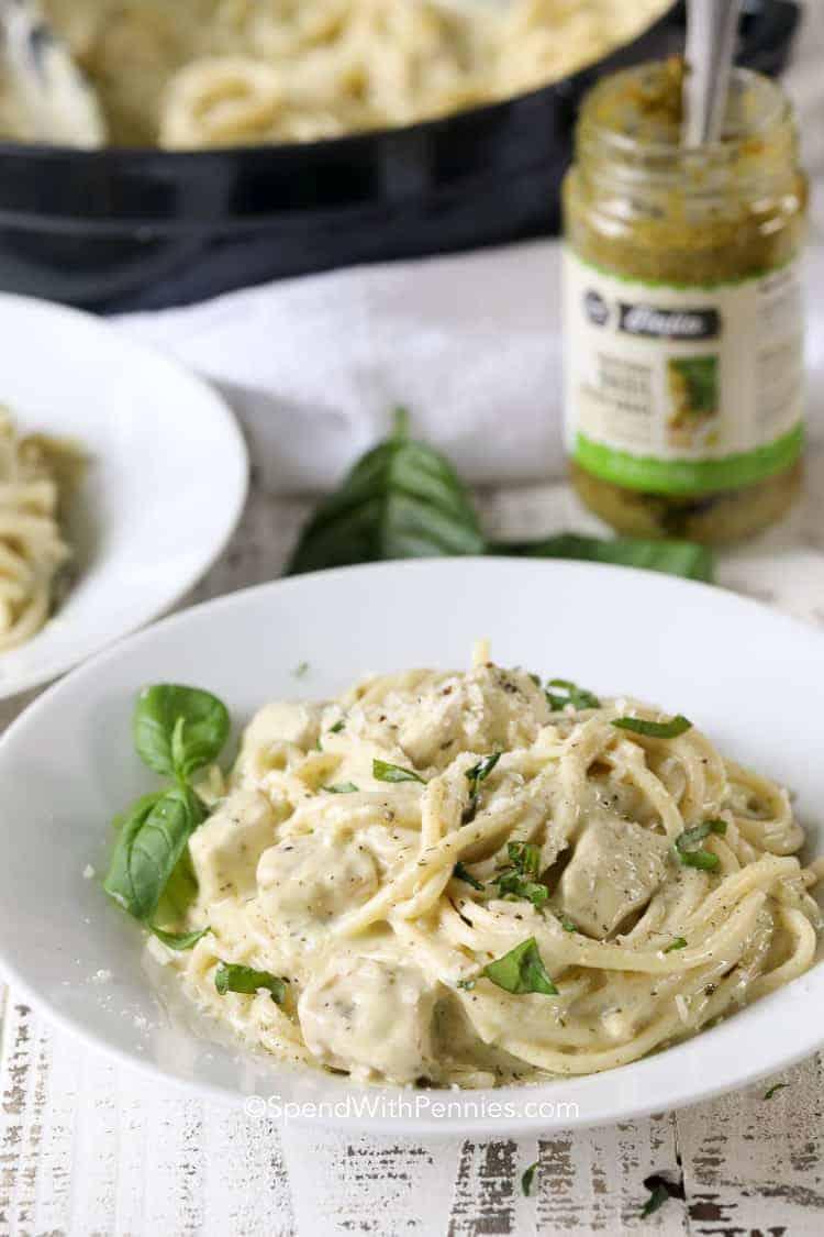 White bowl of Pesto Pasta with basil