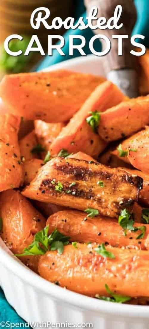 Roasted Carrots in a white dish and garnished with parsley