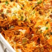 Baking dish full of Baked Spaghetti with serving taken out of it