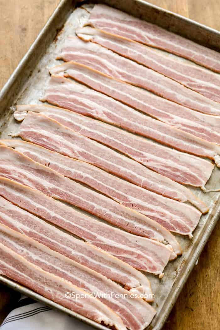 Bacon arranged on a baking sheet as per instructions for how to cook bacon in the oven