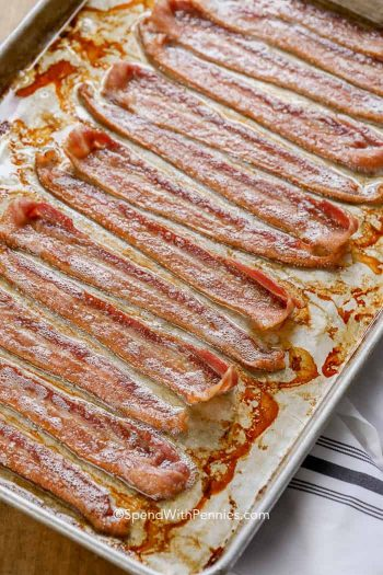 Cooked bacon on a baking sheet