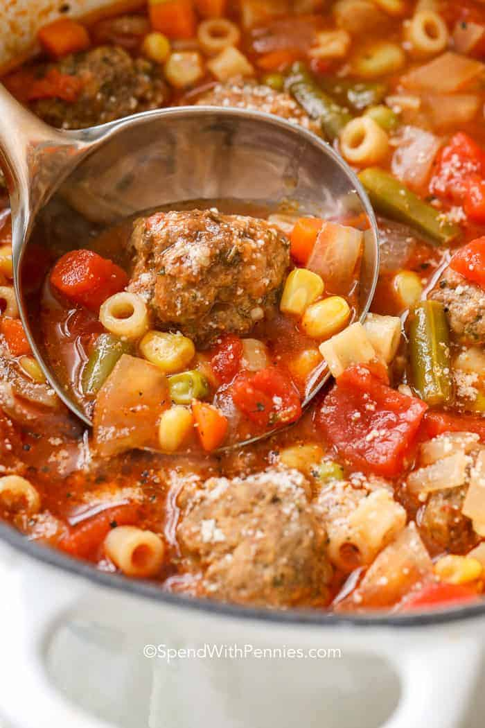 Ladle in a pot of Meatball Soup