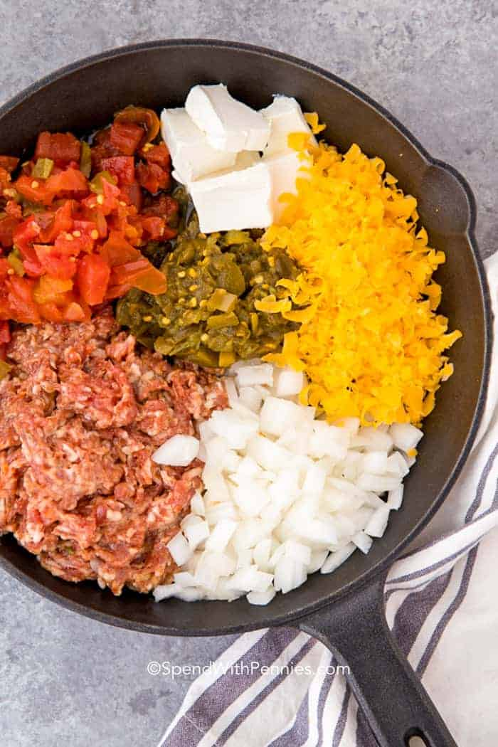 Ingredients prepared in a skillet ready to make easy queso dip