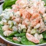 Shrimp Salad served over greens on a white dish