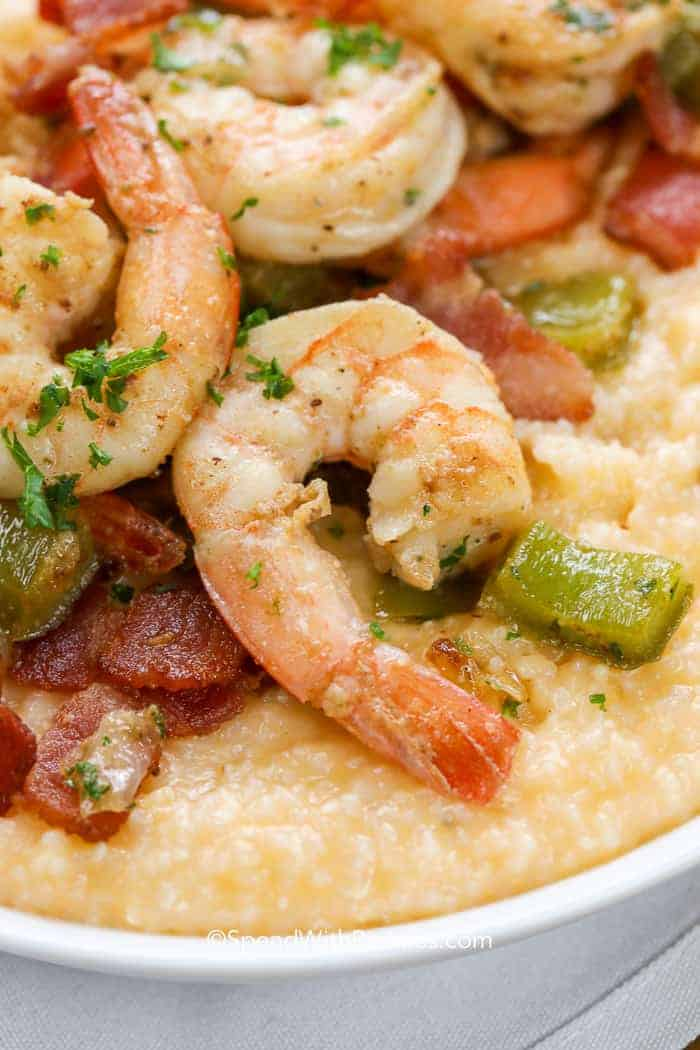 Plump and juicy shrimp on a bed of cheesy grits with bacon and parsley.