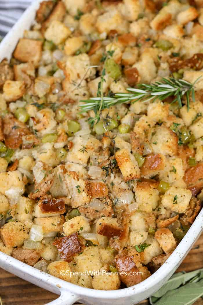 A close up of this easy stuffing recipe baked until moist and golden topped with fresh rosemary.