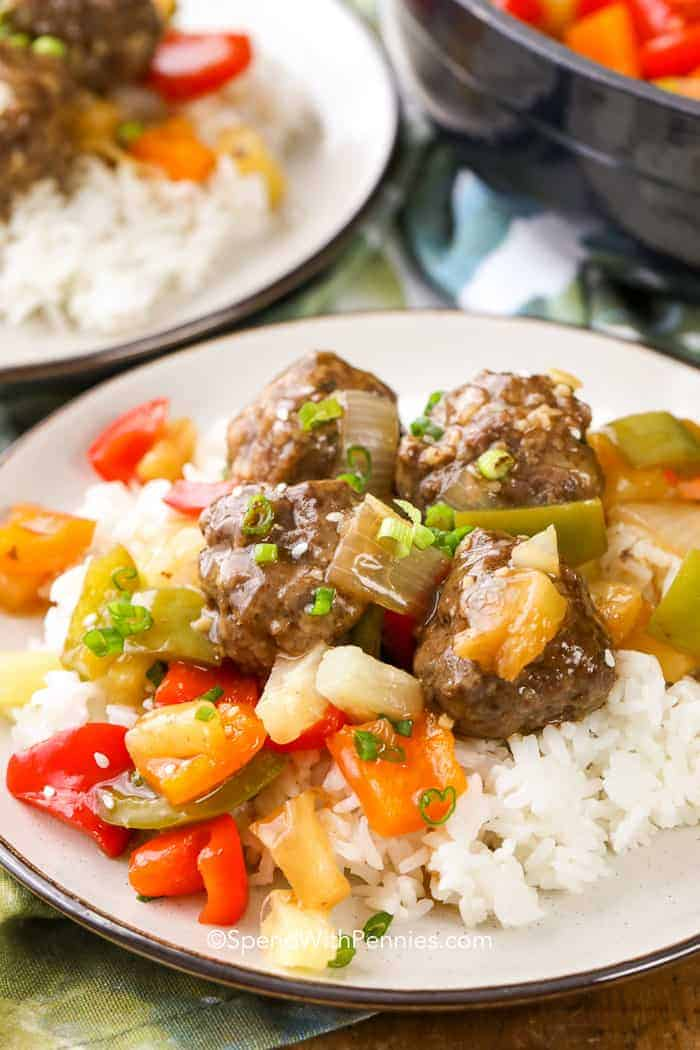 Sweet and sour meatballs served over a bed of white rice