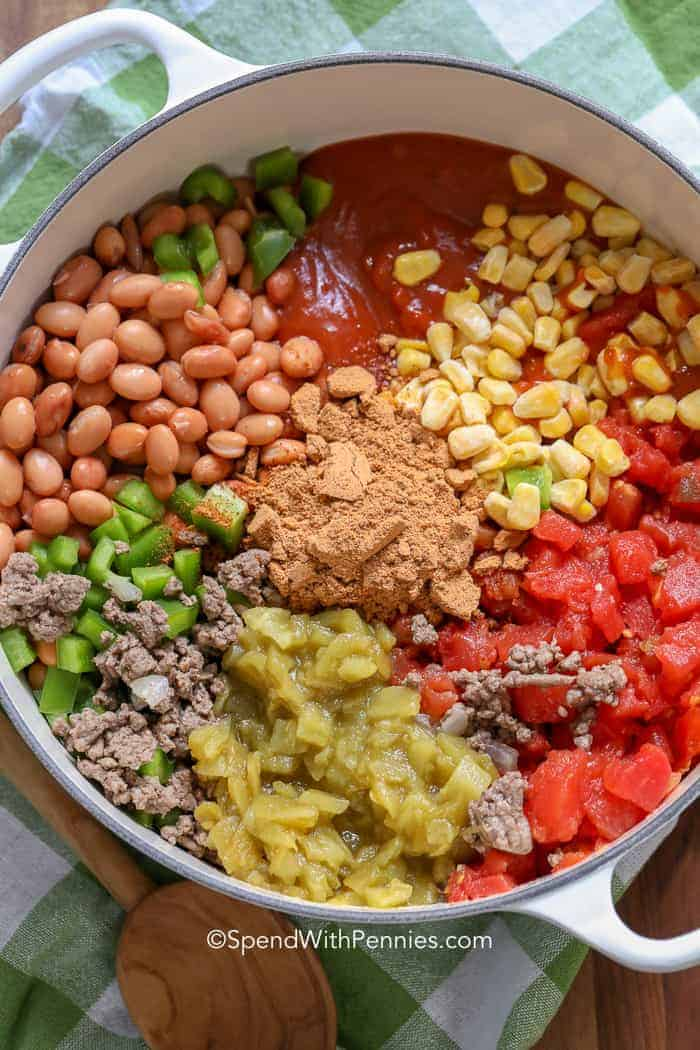 Taco soup ingredients in a pot before mixing together