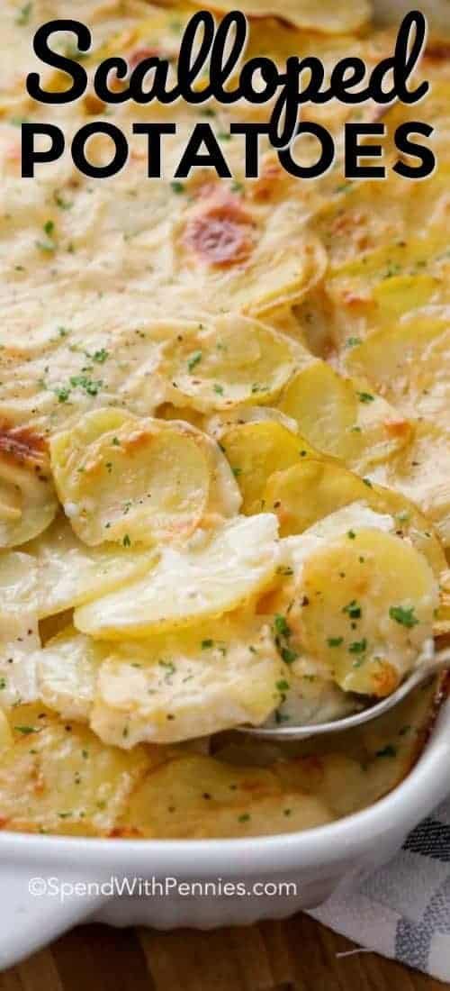 A pan of baked scalloped potatoes being served shown with a title
