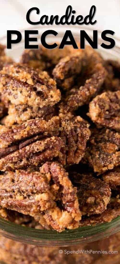 Candied Pecans piled high in a clear jar