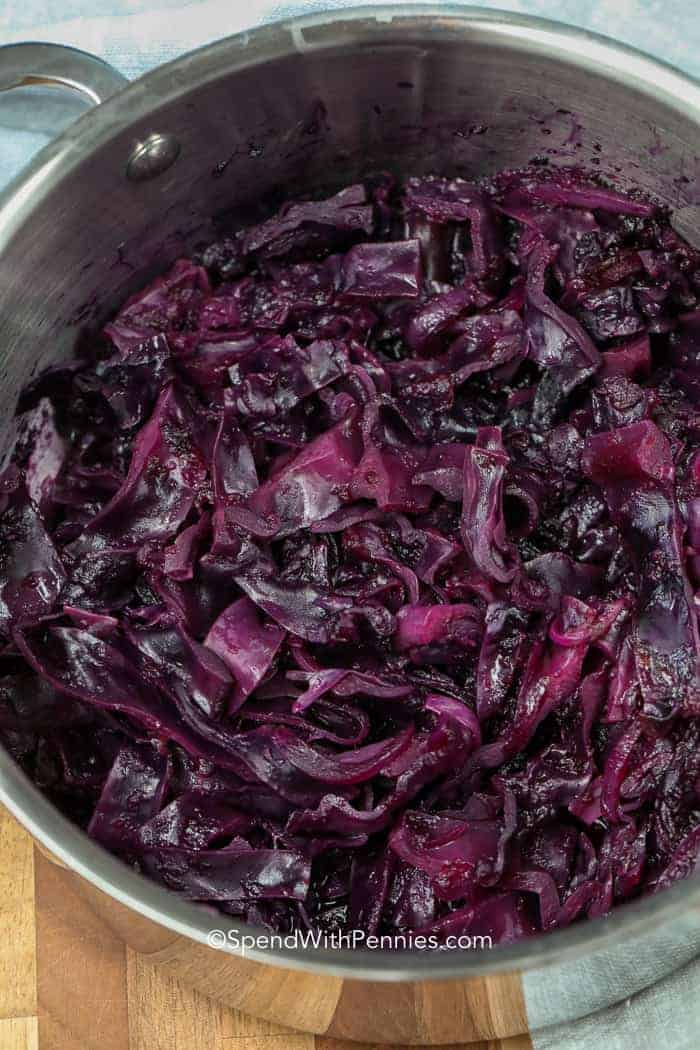 Colorful braised red cabbage in a stock pot.