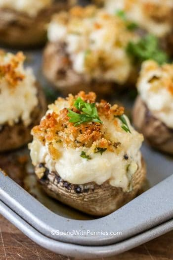 Crab Stuffed Mushrooms on pan with herbs