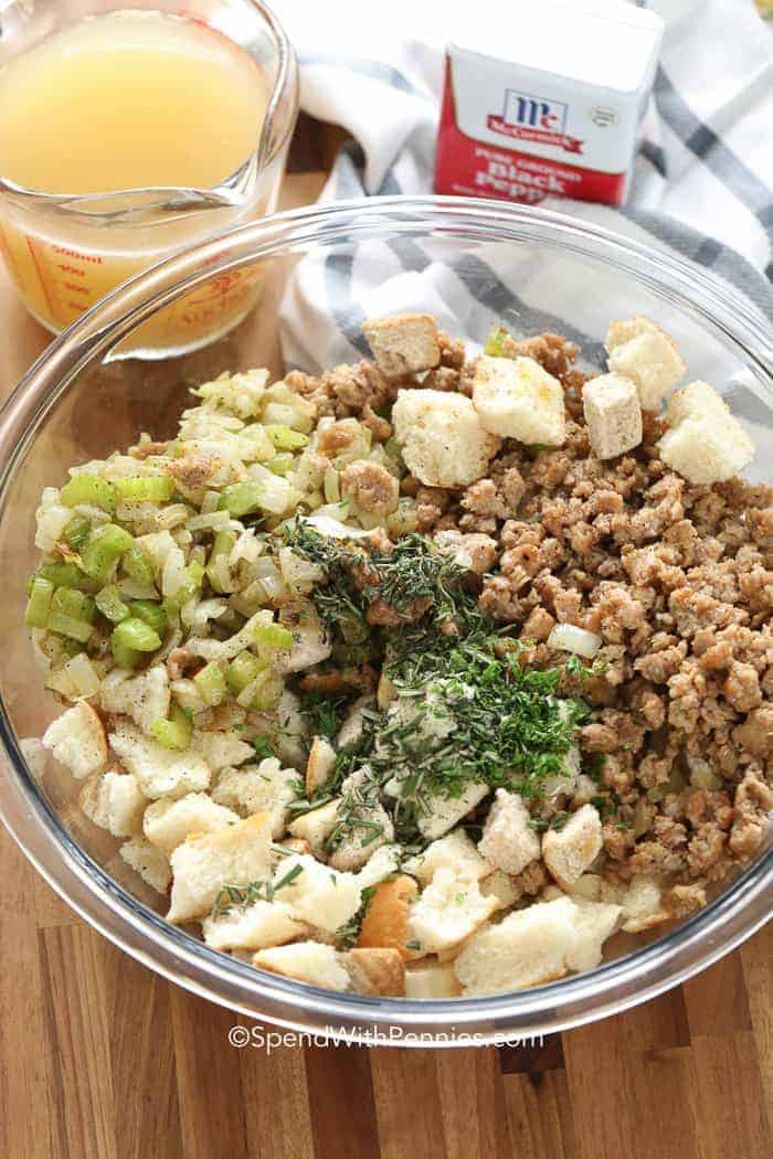 A bowl of dry stuffing ingredients to make the best sausage stuffing of all time!