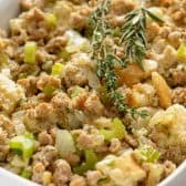 sausage stuffing dish with herbs in white pan