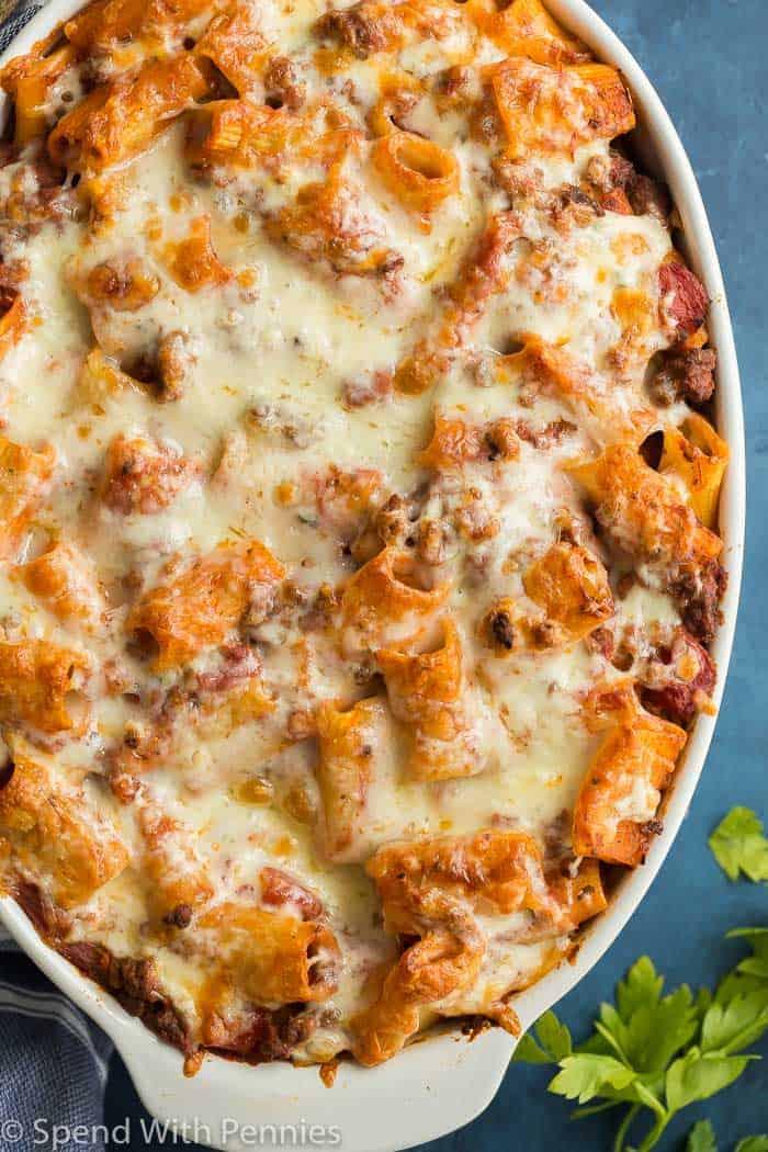 baked rigatoni pasta in a white casserole dish overhead