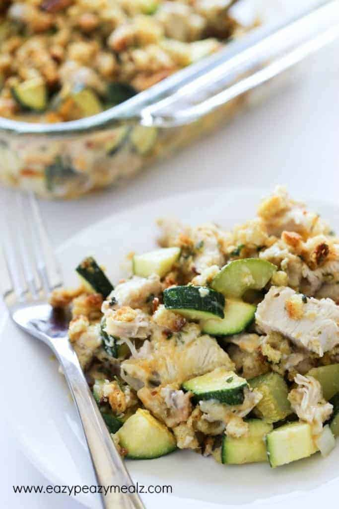 Turkey zucchini casserole on a white plate with a silver fork.