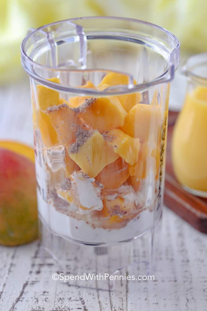 Ingredients for easy Mango Smoothies in a blender