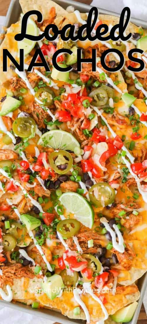 Loaded Nachos are the best snack food, perfect for a party, an easy dinner or a midnight snack! Crispy tortilla chips are topped with seasoned chicken, cheese, and baked until the cheese is bubbly! #spendwithpennies #nachos #loadednachos #easyrecipe #chickennachos