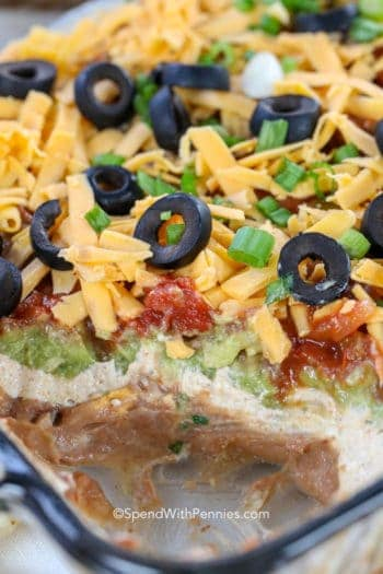 7 Layer Dip in a dish with some taken out