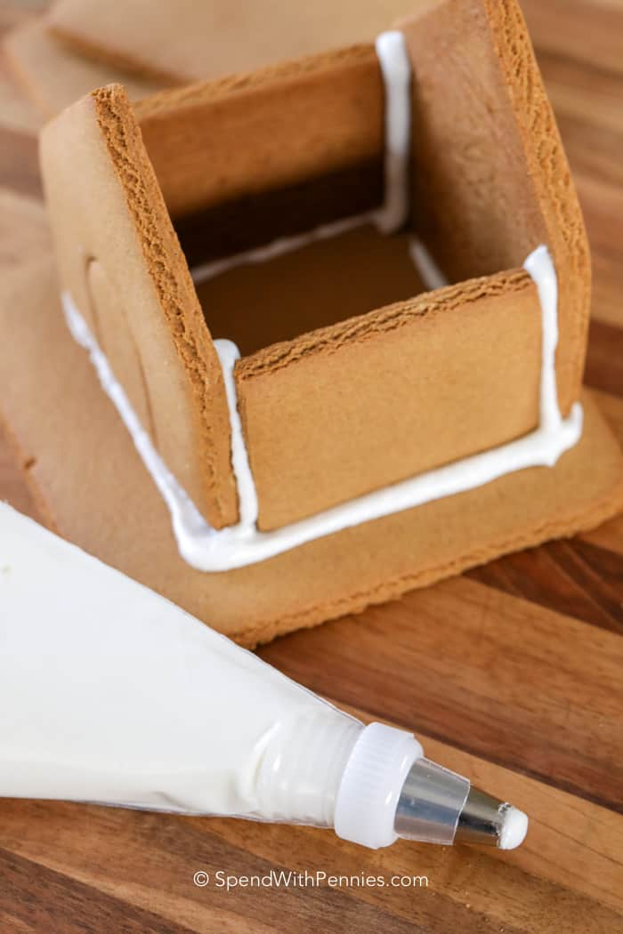 Gingerbread house icing used to assemble a small gingerbread house