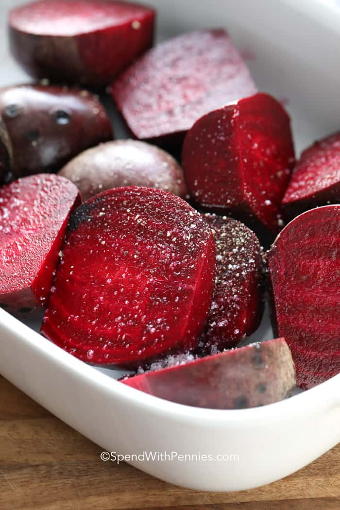 Roasted beets in a casserole dish ready to bake.