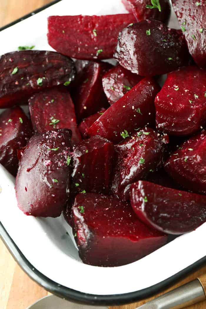 Easy roasted beets ready to serve with fresh parsley.