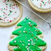 Sugar cookie icing on sugar cookies with sprinkles