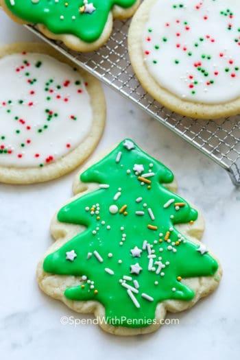 Sugar cookie icing on sugar cookies with sprinkles