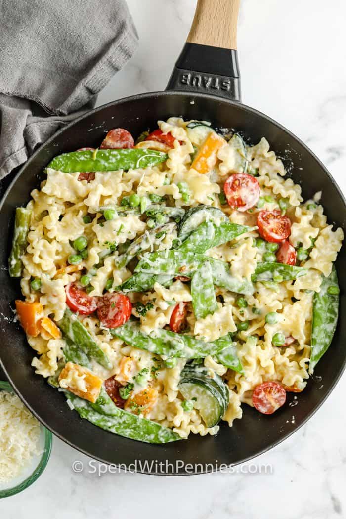 a pan of pasta primavera ready to serve