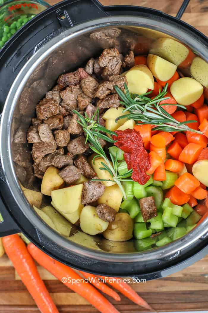 Ingredients for Instant Pot beef stew in a pressure cooker.
