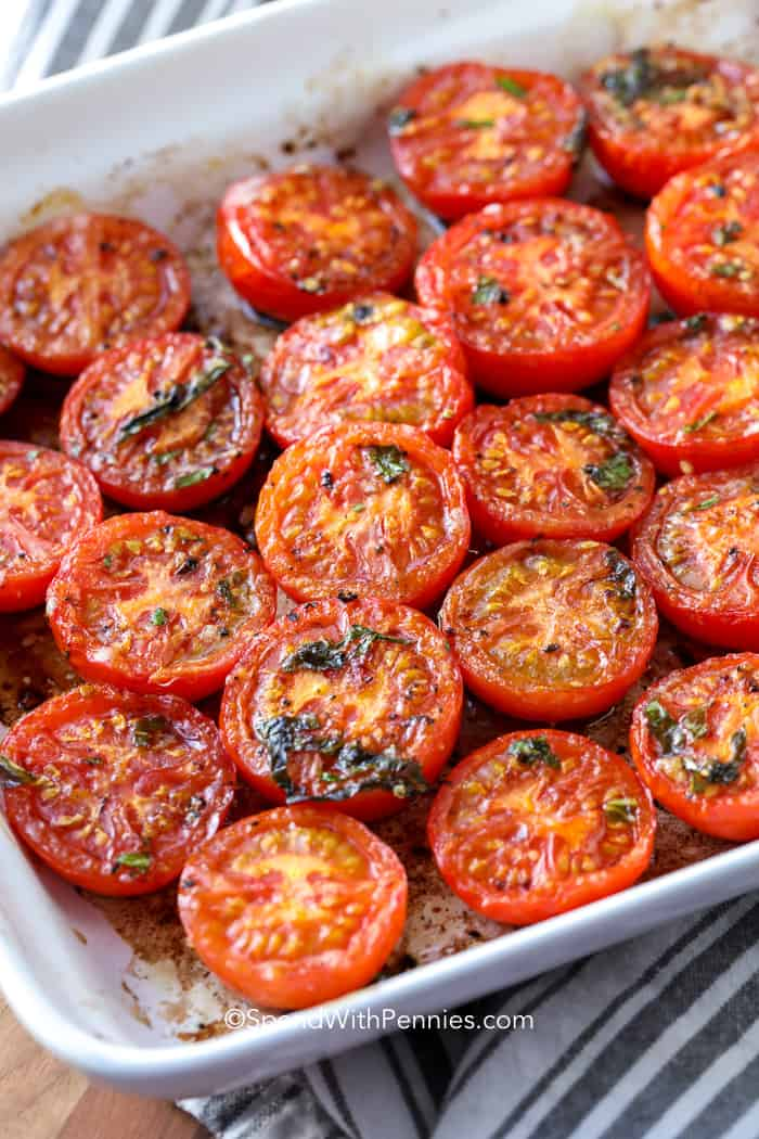 Roasted tomatoes in a baking dish fresh from the oven.