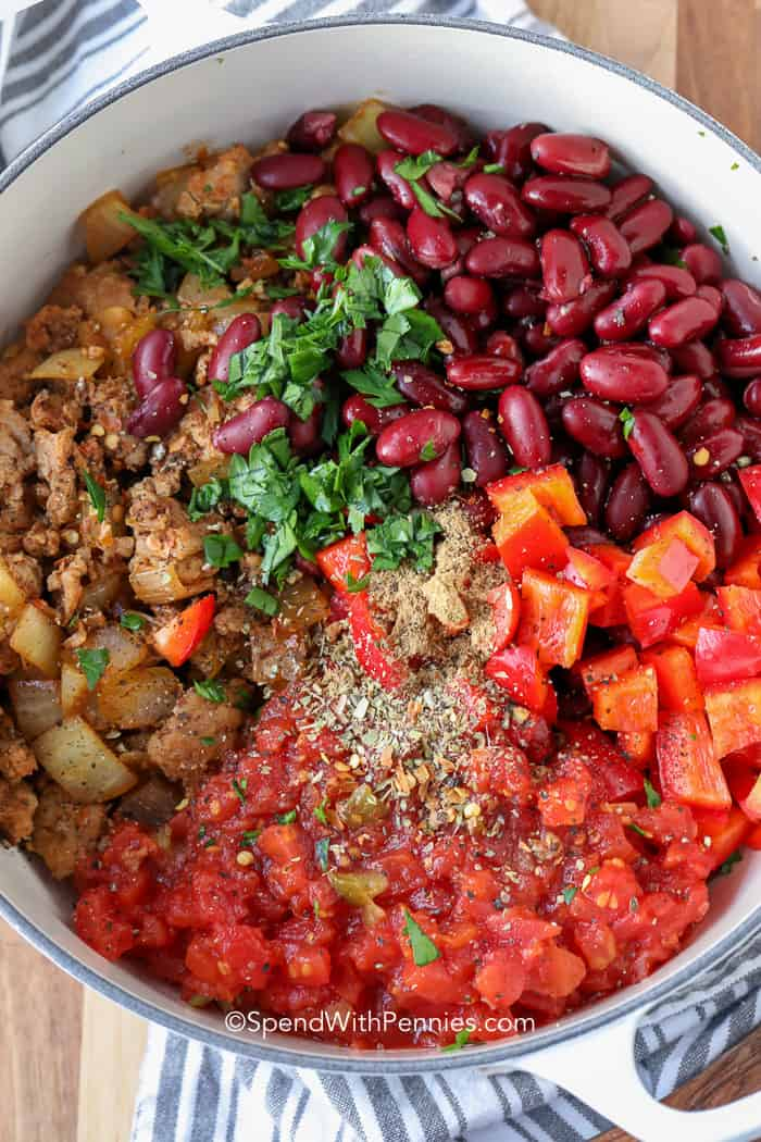 Turkey chili ingredients in a dutch oven ready to simmer.