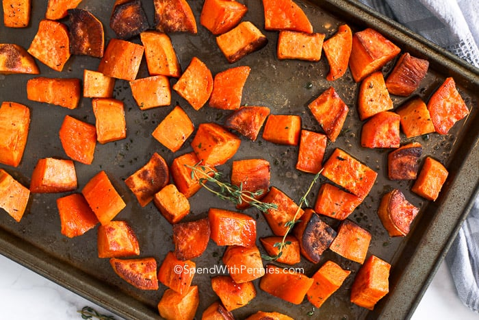 Roasted sweet potatoes baked on a baking sheet