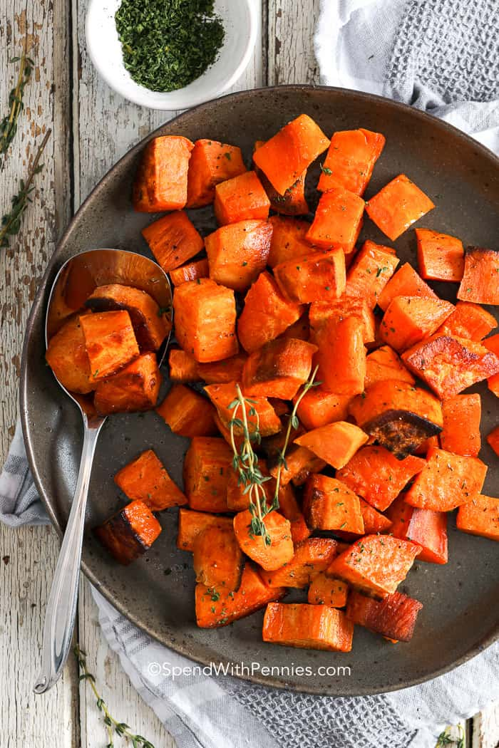 A plate of Roasted Sweet Potatoes with thyme on top