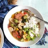 Chicken Gumbo Recipe in a white bowl with rice