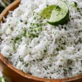 Cilantro Lime Rice in a bowl with lime with a green and yellow napkin