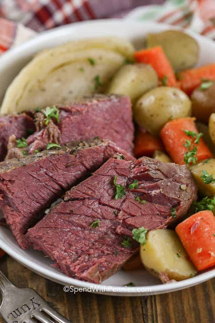 A plate of corned beef served with cabbage, carrots and potatoes